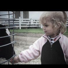 Farm kids are so damn cute! Both animal an human ;)