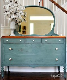 stain the top of the dresser to match the hardwood floor and paint the rest to match the blue gingham furniture in the living room and place under the mermaid and sea glass mirror