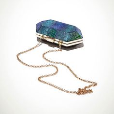 I loved this on #Topshop's Gift Guide. This is a neat holographic type of clutch.