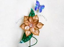 DIY-flower and butterfly stake. Easy! - cut from aluminum cake pans