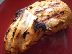 Yummy Yogurt Marinated Chicken from Food.com:   This is really good, and really easy. The yogurt mixture really sticks to the chicken and makes it tasty and tender. Keep in mind it has to marinate for at least 8 hours.