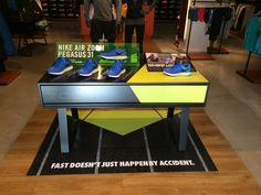 Nike Air Zoom Pegasus 31 - Fast Doesn't Just Happen By Accident sports shoe retail table display.