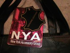 'Genuine Leather Leather New York Accessory Group purse' is going up for auction at  5pm Thu, Jun 27 with a starting bid of $4.