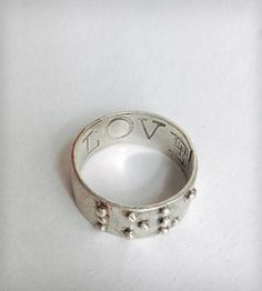 Silver-love-is-blind-braille-ring-1377110385