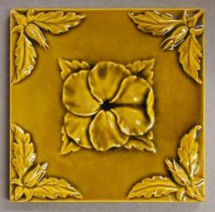 "Maw and Co for C P Sutcliffe and Co, relief moulded dust-pressed tile, pansy design, under a single colour glaze, various colourways exist, 6"" square, c1880. This is one of the company's most popular designs, and was continued by Maw and Co after the closure of C P Sutcliffe."