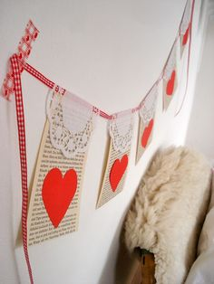 "Cute Valentine's Day Garland Banner made with simple elements: ""old"" book pages, white paper doilies, red hearts, and ribbon! Valentine Banner, Valentines Day Hearts, Valentine Day Love, Funny Valentine, Vintage Valentines, Valentine Crafts, Thanksgiving Banner, Happy Hearts Day, Paper Doilies"