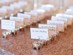 Elephant place card holders from traditional Indian wedding reception  The Wedding Story of Brian & Swapna Eisinger | WeddingDay Magazine