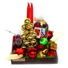 Hamper includes: Pot pourri. 2 long spiral candles. Golden ball decoration. Lots of colorful and fancy Christmas tree decoratives put in together to form this golden wish tray hamper. http://www.tajonline.com/christmas-gifts/product/x1201/christmas-hamper/?aff=pint2013/