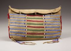 A CROW BEADED BUFFALO HIDE TIPI BAG. . c. 1880. ... American Indian | Lot #77314 | Heritage Auctions