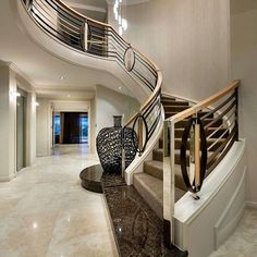 Luxury interiors luxury homes, curved staircase, grand staircase, stair rai Luxury Staircase, Foyer Staircase, Curved Staircase, Staircase Ideas, Railing Design, Staircase Design, Foyer Design, Dream Home Design, Home Interior Design