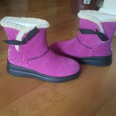 Ugg Boots I am selling a pair of NEW I Heart UGG boots. they are size 7 in Women.  They are super cute. Color is pink.they have side bows and small black her st on the back. They do not come with box. Feel free to ask any questions! thanks for viewing. UGG Shoes