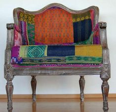 chair upholstered in Bengali kantha quilted fabric