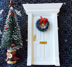 White Christmas Fairy Door With Wreath And Tree by FairyAvenue on Etsy https://www.etsy.com/listing/212476745/white-christmas-fairy-door-with-wreath