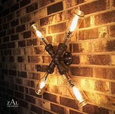 Wall Lamp. Beer bottles,  Plumbing pipe & fittings. Wall light.  Lighting Fixture. Ceiling lamp. $250.00, via Etsy.