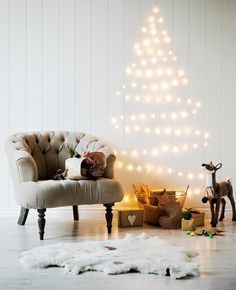Stylish and Simple Christmas Decorating Ideas To fashion a 'tree' from fairy lights, simply shape and tape to the wall. Christmas Fairy Lights, Wall Christmas Tree, Christmas Tree Themes, Simple Christmas, Christmas Home, Christmas Lights, Modern Christmas, White Christmas, Hanging Christmas Decorations