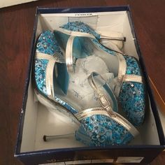 Glamorous jeweled party heels. Bedazzled gorgeous sky blue heels. Worn only once to my husbands dinner party. Got tons of compliments. Unique heels. Ladies you want find another pair like these. I purchased them from a boutique. Shoes Heels