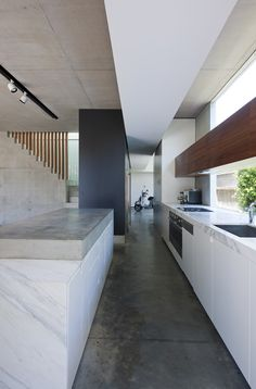 concrete bench + white cabinetry