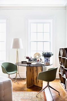 Raw wood dining table with modern green dining chairs in Manhattan on Thou Swell @thouswellblog