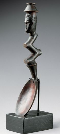 Africa | Spoon from the Baule people of the Ivory Coast | Wood; zigzag shape to the handle, topped with a human head wearing a hat