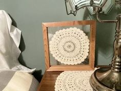 """A decoration for the bedroom 9 1/2"""" x 9 1/2"""" x 1 1/4"""" doily is between 2 pices of acrylic and put in the frame. Borgmanns Creations Wall Hanger, Hangers, Doily Art, Rustic Home Interiors, Country Farmhouse Decor, Hanging Signs, Crochet Doilies, Special Gifts, Bedroom Decor"""