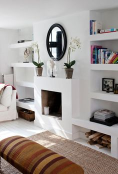 large circular mirror | contemporary fireplace | residential interior | modern living room with built-in bookshelves | interior design | blog