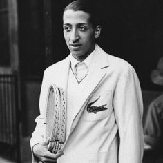 "René Lacoste (1904-1996), winner of 7 major tennis titles and nicknamed the ""crocodile"" by his friends, developed the first tennis ball machine and the first metal racket, and began a little clothing line in 1933-black history archives"