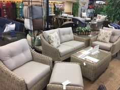NCI/Chicago Wicker - Cambria small scale seating. Loveseat, Swivel Glide Lounge, Lounge, Ottoman, Coffee, End table and Rotating Chat table available.