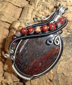 Wire Wrapped Pendant  Red and Black Agatized Dinosaur Bone