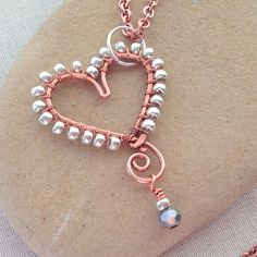 DIY heart shaped wire pendant with seed bead edge wrap and crystal dangle. From Lisa Yang's Jewelry Blog: How to Wrap Beads to the Outside of a Wire Frame, Free Tutorial