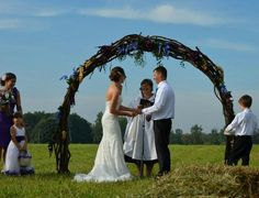 Our rustic wedding arch<3