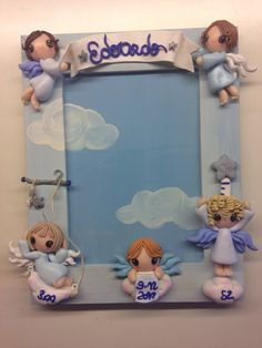 Angel Frame , with data of born, weight and lenght : hand painted and decorated with fimo.
