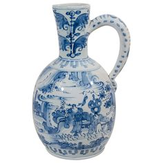 18th Century Dutch Delft Blue and White Wine Jug   From a unique collection of antique and modern delft and faience at https://www.1stdibs.com/furniture/dining-entertaining/delft-faience/