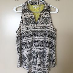 Tribal Print Blouse Purchased from Nordstrom. Yellow lace in the back, tribal print blouse. Tops Blouses