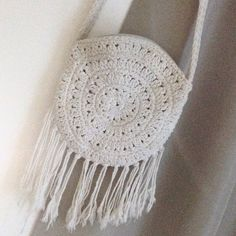 White Woven Crossbody Bag Beautiful white crochet fringe cross body bag. Condition 7/10, has small stain on one side!mo tag, zipper closure, Beautiful woven cross body strap. ASOS Bags Crossbody Bags