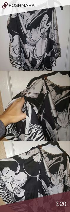 """WHBM floral print tunic WHBM black and white floral tunic with small animal print bands. Has an Elastic waist. Very beautiful and flowy! I believe it used to have a toe (they are small Slits at the sleeve/waist connection), but I no longer have it and never even wore it with the tunic. It also has small brown """"buckles"""" at the shoulders. White House Black Market Tops Tunics"""