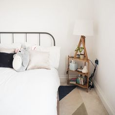 After 3 years of sleeping on mysteriously stained uni-house beds then 7 months on a futon at my parents I can't tell you how excited I am to be sleeping on my own REAL LIFE BED in our own REAL LIFE FLAT. The bedroom is coming along and is cosy and lovely but i think we could do with some artwork and a throw or two
