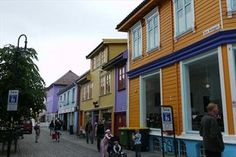 "Nicknamed ""The Colourful Street"" and have a bunch of nice cafées. Tourist Sites, Stavanger, Attraction, Tourism, Street View, Spaces, Explore, Nice, Building"