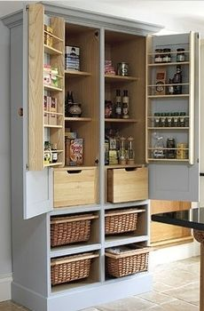 Small kitchen? Turn an old tv armoire into a pantry cupboard or crafting storage space