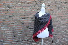 This is my first wrap design and I am pleased to share it with you for free. It's an elegant design that is finished with a playful beaded edge. The black and red yarn work lovely together and the black beads are the finishing touch.