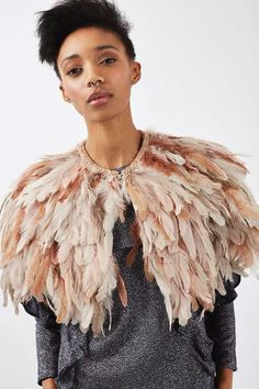 Elevate your outerwear in this nude feather fringe cape. In a cropped style, we love to wear it with a warm knit for the day or sheer blouse at night. #Topshop