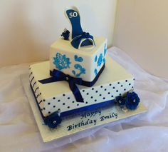 https://flic.kr/p/KUj96y | Two tier white & royal blue birthday cake with edible lace & fondant high heel & roses