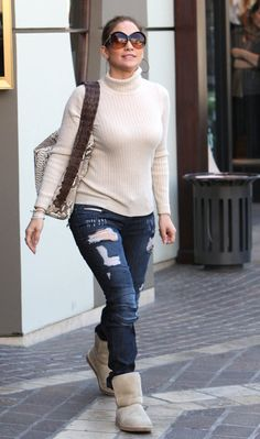 Jennifer Lopez got comfy in Ugg's - matching her shoes with a pair of ripped jeans and a polo shirt in the same color as her Ugg's!
