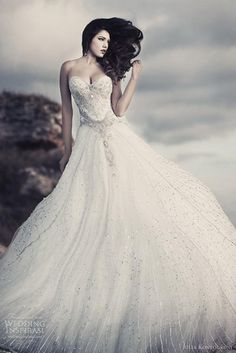 I'm not really into big poofy dresses, but this would be gorgeous at a beach wedding!