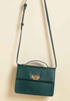 <p>At a glance, you can tell this teal purse is the ultimate accessory, but we'll review everything that makes it great! Crafted from vegan-friendly faux leather, secured with a sleek gold clasp, and designed to hold your cosmetic and tech necessities, this crossbody bag checks out as an absolute must-have.</p>