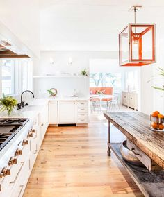 Rustic Modern Kitchen with white countertops and wide wooden plank floors