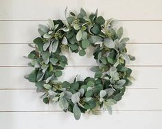 This lambs ear, eucalyptus, and eucalyptus berry wreath is designed with the highest quality faux greenery. It is simple and exceptionally beautiful. This wreath is perfect for over a fireplace, bed, or any wall where you are looking for a subtle, yet striking piece of decor. It would also look amazing on your front door, but should not be placed in direct sunlight or where it will get wet. Size: This wreath has a diameter of about 21 inches measuring to where most of the greenery ends. Some…