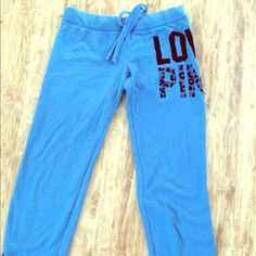 "PINK Sweatpants. Cinched ankle design (can you see a pattern?) blue sweatpants that have ""love pink"" in black and cheetah print around the right hip.   Says XS, but they run large. Inseam: 32 inches                                                                   EUC, no stains, rips, etc.                                      NO TRADES, FIRM PRICE PINK Victoria's Secret Pants Ankle & Cropped"