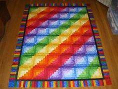 rainbow log cabin quilt top
