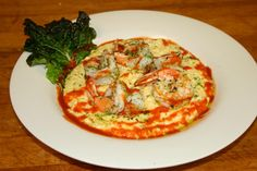 Shrimp and Cheddar Cheese Grits with our house made Sriracha sauce from Bread Winners Cafe and Bakery in Dallas, TX.