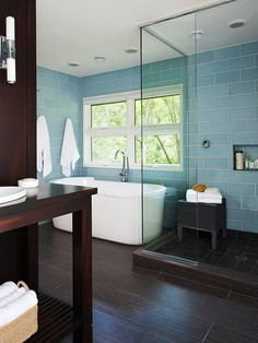 We love the beautiful blue tile in this luxurious bathroom! More bathroom tile designs: interior design bathroom design Glass Tile Bathroom, Bathroom Tile Designs, Bathroom Renos, Glass Tiles, Bathroom Wall, Modern Bathroom, Brown Bathroom, Bathroom Ideas, Tub Tile